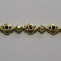 18ct yellow gold, ruby and diamond, patterned bracelet.
