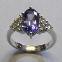 18ct White gold, tanzanite and diamond cluster ring