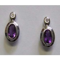 18ct white gold, amethyst and diamond stud earrings.