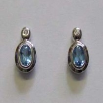 18ct white gold, blue topaz and diamond stud earrings.
