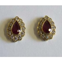 18ct yellow gold pear shaped ruby and diamond cluster earrings.