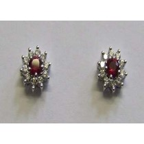 18ct white gold ruby and diamond cluster earrings.