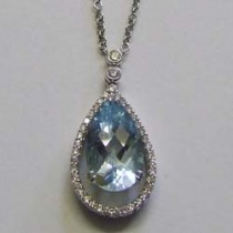 18ct white gold blue topaz and diamond pendant on a white gold and diamond chain.