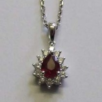 "18ct white gold pear shaped ruby and diamond cluster pendant on a white gold 16""chain."