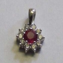 18ct white gold ruby and diamond cluster pendant.