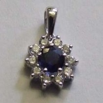 18ct white gold sapphire and diamond cluster pendant.