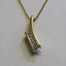 18ct yellow gold and princess cut diamond pendant.