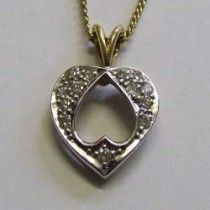 18ct yellow and white gold and diamond pierced heart pendant.