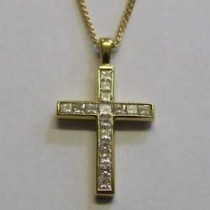 18ct yellow gold and diamond cross pendant.