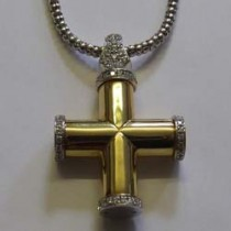 18ct white and yellow gold diamond set cross pendant.