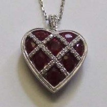 18ct white gold, diamond and ruby heart pendant.