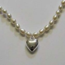 Sterling silver and pearl, heart necklace, by Molly Brown.