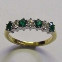 18ct yellow and white gold 4 Emerald 3 Diamond ring.