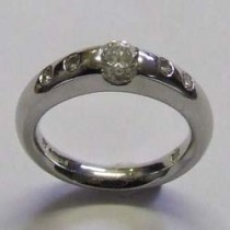 Platinum 5 stone flush round brilliant ring.