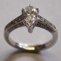 Platinum & Diamond Pear Shaped Diamond Ring with Pave shoulders