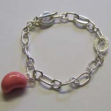 Strawberry jelly bean charm bracelet, by Molly Brown.