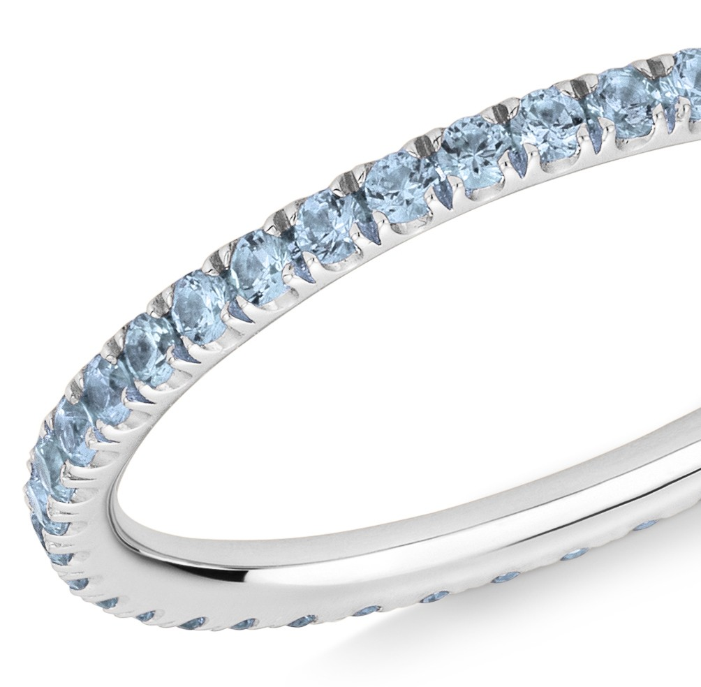 86208f40834db 18CT WHITE GOLD AND BLUE TOPAZ MICRO-SET ETERNITY RING